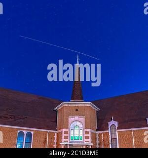 Square frame Front view of a beautiful brick church in Provo Utah with deep blue sky overhead