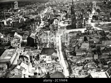 In Europe, some churches have been completely ruined, but others still stand amid utter devastation. Mönchengladbach Cathedral stands here in the rubb