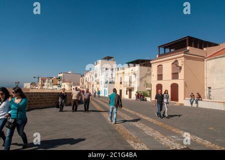 Alghero, Sardinia / Italy - April 10, 2011: Waterfront in the coastal town of Alghero with incidental people walking, Sardinia, Italy