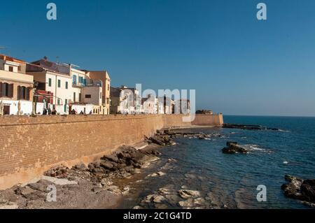 Waterfront with Mediterranean sea in the coastal town of Alghero during the sunset, Sardinia, Italy