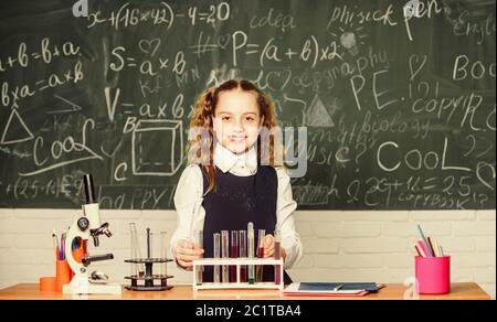 student doing biology experiments with microscope. Little child at school lesson. Chemistry. Back to school. childrens day. Little girl learning chemistry in school lab. She need an expert advice.