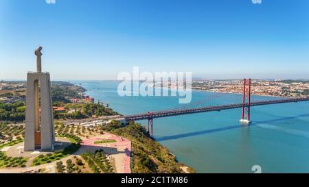 Aerial bridge on April 25th, Lisbon, Portugal. Statue of jesus christ lisbon. Close-up.