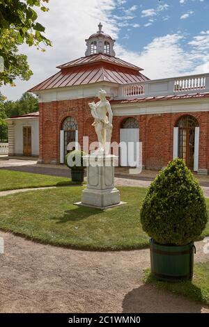 Statue in front of Monplaisir Palace at Peterhof gardens, close to St. Petersburg in Russia - Stock Photo