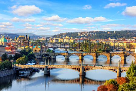Charles bridge and other Prague bridges over the Vltava river, beautiful summer view. - Stock Photo