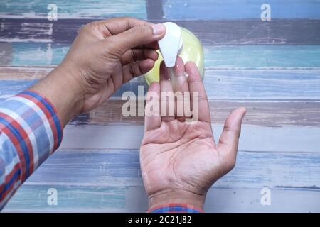 man's hands using hand sanitizer gel, Top view  - Stock Photo