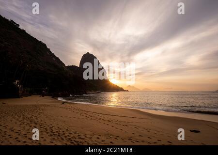 Beautiful view to Sugar Loaf Mountain during the sunrise from Vermelha Beach, Rio de Janeiro, Brazil - Stock Photo
