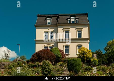 lonely villa on a green hill with blue sky - Stock Photo