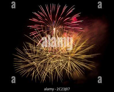 fireworks in the dark sky background - Stock Photo