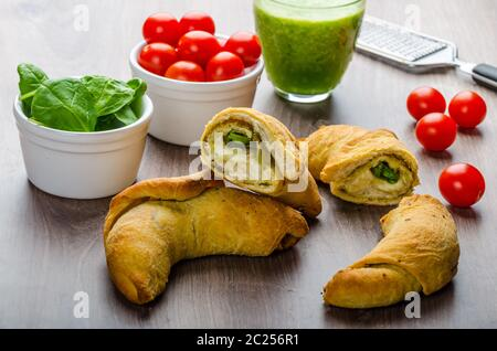 Mini Calzone roll with herbs and cheese, fresh herbs smoothie - Stock Photo