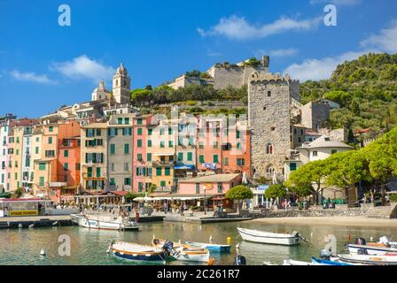 The colorful seaside village, harbor, bay and beach of Portovenere, Italy, an Unesco World Heritage site on the Ligurian coast - Stock Photo