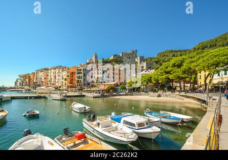 The colorful village, marina, sea, boats and sandy beach at Portovenere, Italy, along the Ligurian coast of the Cinque Terre and Gulf of Poets. - Stock Photo