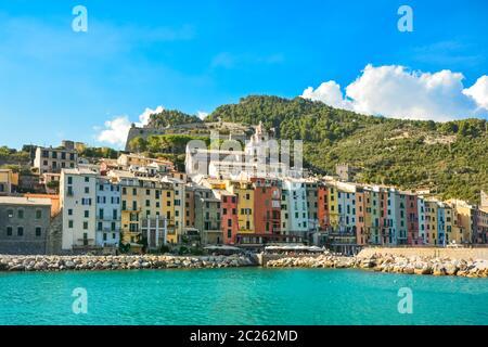 The colorful coastal village of Porto Venere, Italy, on the Ligurian coast, with it's sidewalk cafes, shops and marina. - Stock Photo