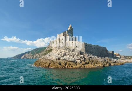 The imposing Church of St. Peter and the Doria Castle on the rocky peninsula at the entrance to Porto Venere Italy on the Ligurian Coast. - Stock Photo