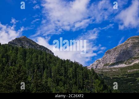 Mountain Range Landscape, panoramic of european alps with clouds - Stock Photo