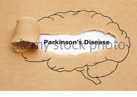 Concept with text Parkinsons Disease appearing behind torn brown paper with human brain drawing. - Stock Photo