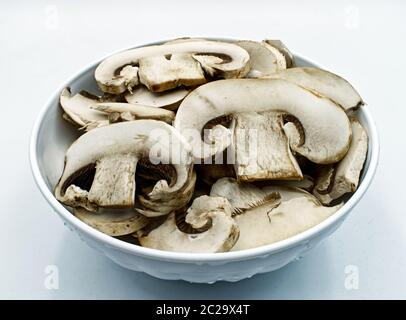 Fresh champignon mushrooms in a bowl isolated on white