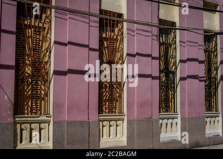 Row of identical windows with grille on a building in Havana Centro, Havana, Cuba - Stock Photo
