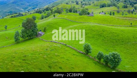 Aerial view with a drone of the spring landscape of pasiegas cabins and meadows in Miera Valley in Autonomous Community of Cantabria. Spain, Europe