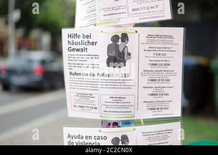 Leipzig, Germany. 16th June, 2020. Notices in various languages on the subject of domestic violence in connection with Corona are hung on a street. Credit: Sebastian Willnow/dpa-Zentralbild/ZB/dpa/Alamy Live News - Stock Photo