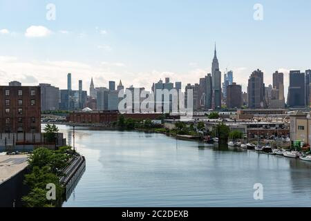 New York, NY / USA - JUN 01 2018: Manhattan midtown skyline view from Queens on a clear afternoon