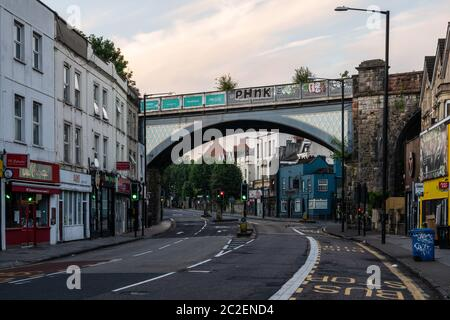 'The Arches', a cast iron Victorian viaduct, carries the Severn Beach Line suburban branch railway across Cheltenham Road, a main shopping street in N - Stock Photo