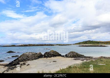Loch nan Ceall and white sands beach at Arisaig inverness-shire Scotland - Stock Photo