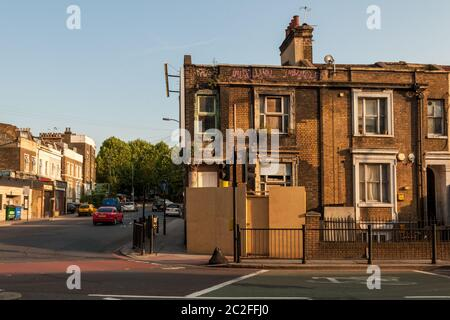 London, England, UK - June 28, 2010: A derelict house stands boarded up on the New Cross Road in South East London following the 'credit crisis' reces - Stock Photo