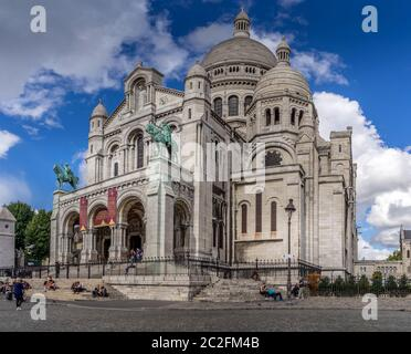 Basilica of the Sacre Coeur, dedicated to the Sacred Heart of Jesus in Paris - Stock Photo