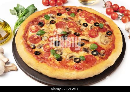 Pepperoni pizza with ingredients on a white background, close-up shot - Stock Photo