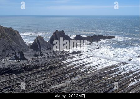 The dramatic, rugged coastline at Hartland Quay, north Devon. Facing south. - Stock Photo