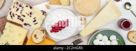 A panorama of cheeses, shot from the top. Cheese platter flat lay. - Stock Photo