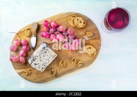 Gorgonzola cheese, shot from the top with a glass of wine and a place for text - Stock Photo