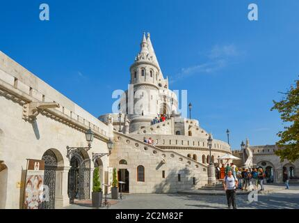 Tourists enjoy a sunny day at Fisherman's Bastion, part of the Buda Castle Complex in Budapest Hungary. - Stock Photo