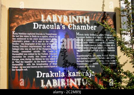 Sign outside the entrance to Dracula's Chamber, inside the Buda Castle Labyrinth in Budapest Hungary. - Stock Photo