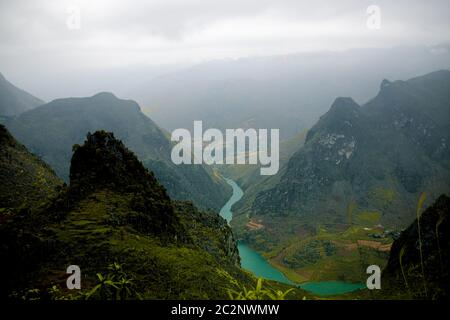 Cinematic scenery of the karst mountain range of the famous Ha giang Loop in Vietnam - Stock Photo