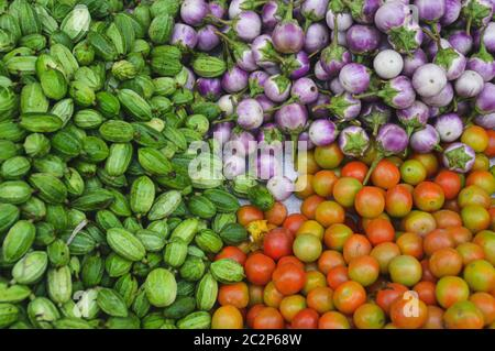 Fresh harvest of organically grown cucumbers, kermit eggplants and tomatoes - Stock Photo