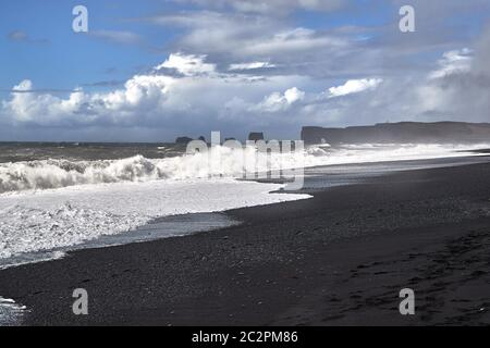 Waves at Rejnisfjara black sand beach, slow motion form 120 fps - Stock Photo