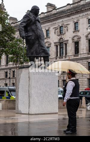 Westminster, London, UK. 18th Jun, 2020. The statue of Winston Churchill outside the Palace of Westminster has been uncovered following the actions taken to prevent it from being further vandalised during Black Lives Matter protests. French President Emmanuel Macron is visiting London on the 80th anniversary of the 'Appel' speech by Charles de Gaulle which is considered to be the origin of the French Resistance to the German occupation during World War II, so the statue has been revealed. Heritage Warden standing guard