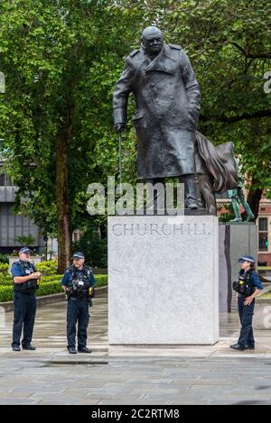 Westminster, London, UK. 18th Jun, 2020. The statue of Winston Churchill outside the Palace of Westminster has been uncovered following the actions taken to prevent it from being further vandalised during Black Lives Matter protests. French President Emmanuel Macron is visiting London on the 80th anniversary of the 'Appel' speech by Charles de Gaulle which is considered to be the origin of the French Resistance to the German occupation during World War II, so the statue has been revealed. Police officers standing guard