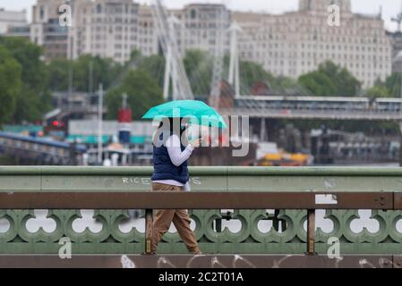 Westminster, London, UK. 18th Jun, 2020. The morning has dawned wet as commuters make their way to work during the COVID19 Coronavirus pandemic lockdown period