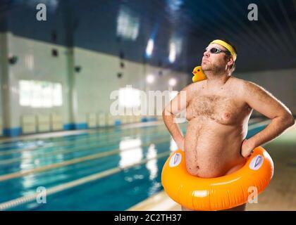 Freak man having fun in the pool - Stock Photo