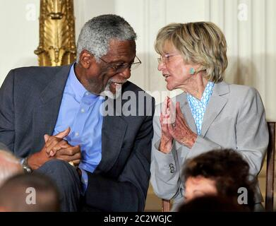 Bill Russell, left, and Jean Kennedy Smith, right, share a thought during the ceremony where United States President Barack Obama and first lady Michelle Obama honor them and the other recipients of the 2010 Medal of Freedom, 'the Nation's highest civilian honor presented to individuals who have made especially meritorious contributions to the security or national interests of the United States, to world peace, or to cultural or other significant public or private endeavors', in a ceremony in the East Room of the White House in Washington, DC on Tuesday, February 15, 2011.Credit: Ron Sachs / - Stock Photo