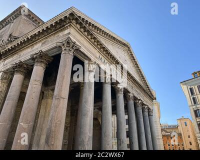 Wide angle shot of the facade with columns of the Pantheon in Rome.