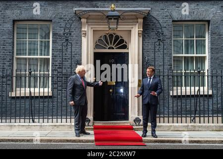 Prime Minister Boris Johnson welcomes French president Emmanuel Macron to Downing Street in London during his visit to the UK. - Stock Photo