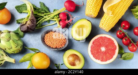 Vegan food, panoramic overhead shot. Healthy diet concept. Fruits, vegetables, legumes, shot from the top. A flat lay - Stock Photo