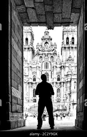 Silhouette of a man standing in front of the Santiago de Compostela Cathedral, Santiago de Compostela, Galicia, Spain - Stock Photo