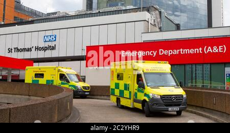 London, UK - June 17th 2020: Ambulances parked up outside the Accident and Emergency department at St. Thomas Hospital in London, UK. - Stock Photo