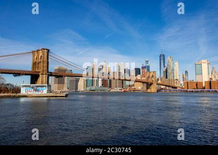 View from Main Street Park over the East River to the skyline of Lower Manhattan with Brooklyn Bridge, Dumbo, Downtown Brooklyn, Brooklyn, New York - Stock Photo