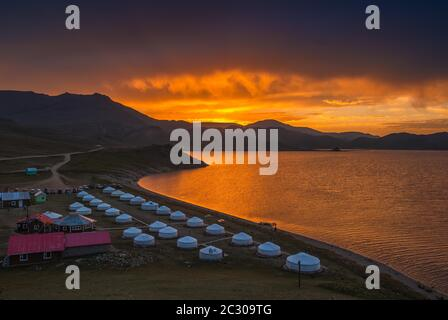 Sunrise at White Terkh Lake, ger, nomad tent, resort on the shore of the lake, Arkhangai Province, Mongolia - Stock Photo