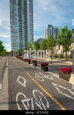 Calgary, Alberta - June 12, 2020: View of a dedicated bicycle path in Calgary Alberta. - Stock Photo